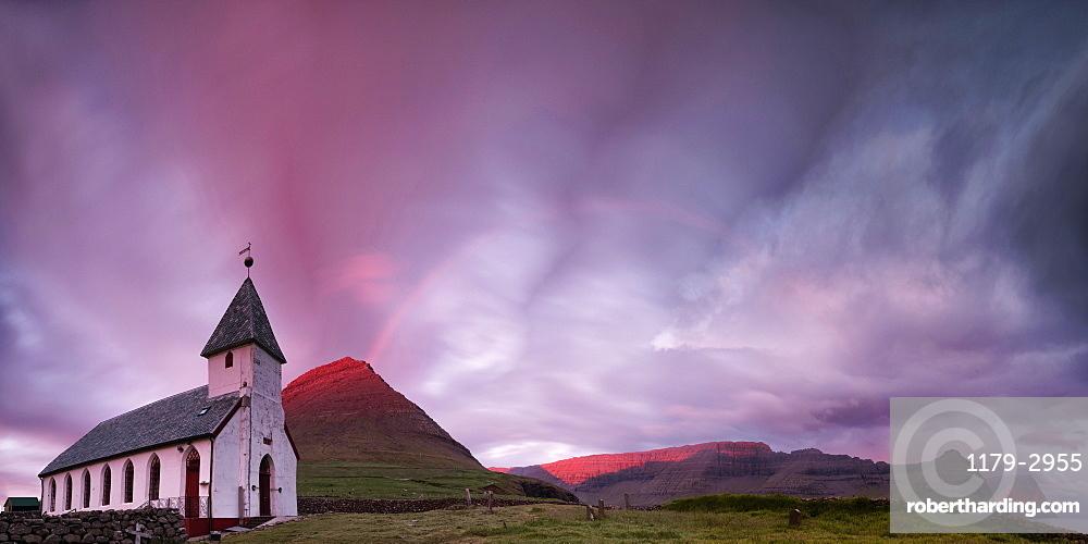 Panoramic of church of Vidareidi at sunrise, Vidoy island, Faroe Islands, Denmark