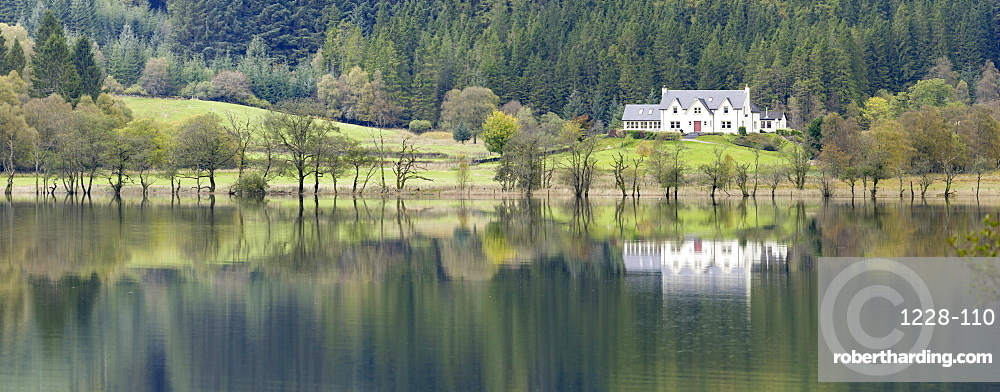 White house overlooking Loch Chon, The Lomond and Trossachs National Park, Sterlingshire, Scotland.