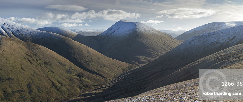 View down Bowderdale to the snow capped peaks of Yarlside and Cautley Crag, Howgill Fells near Sedbergh, Cumbria, United Kingdom, Europe