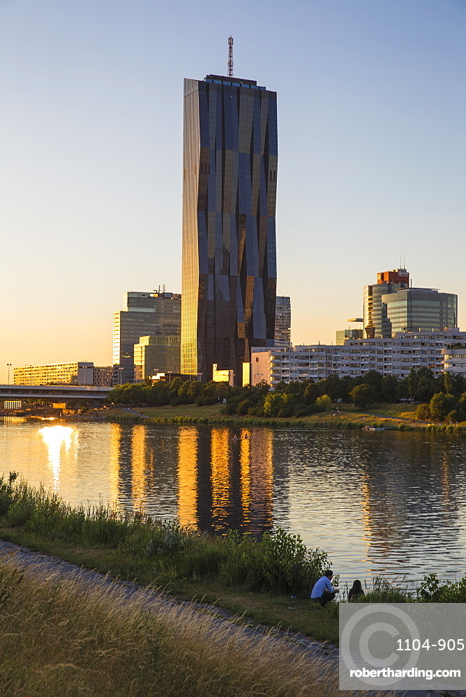Donau City and DC building reflecting in New Danube River, Vienna, Austria, Europe