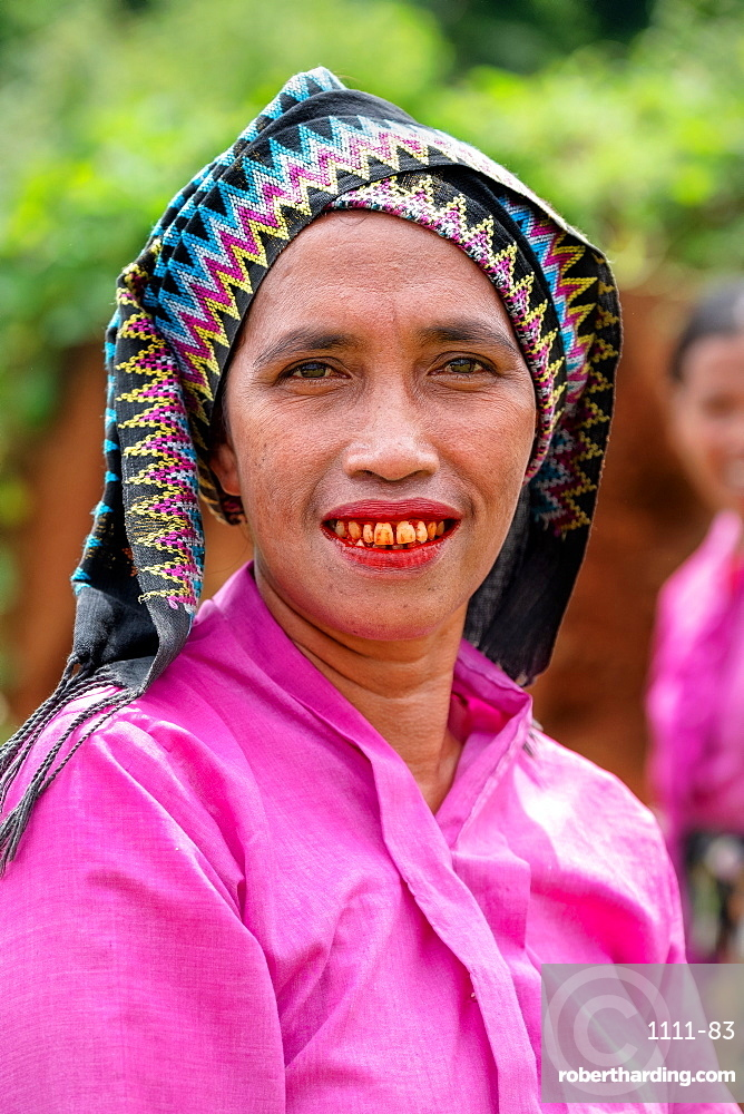 A Manggarai women eating betel nut which causes reddening of the tongue and teeth, western Flores, Indonesia, Southeast Asia, Asia