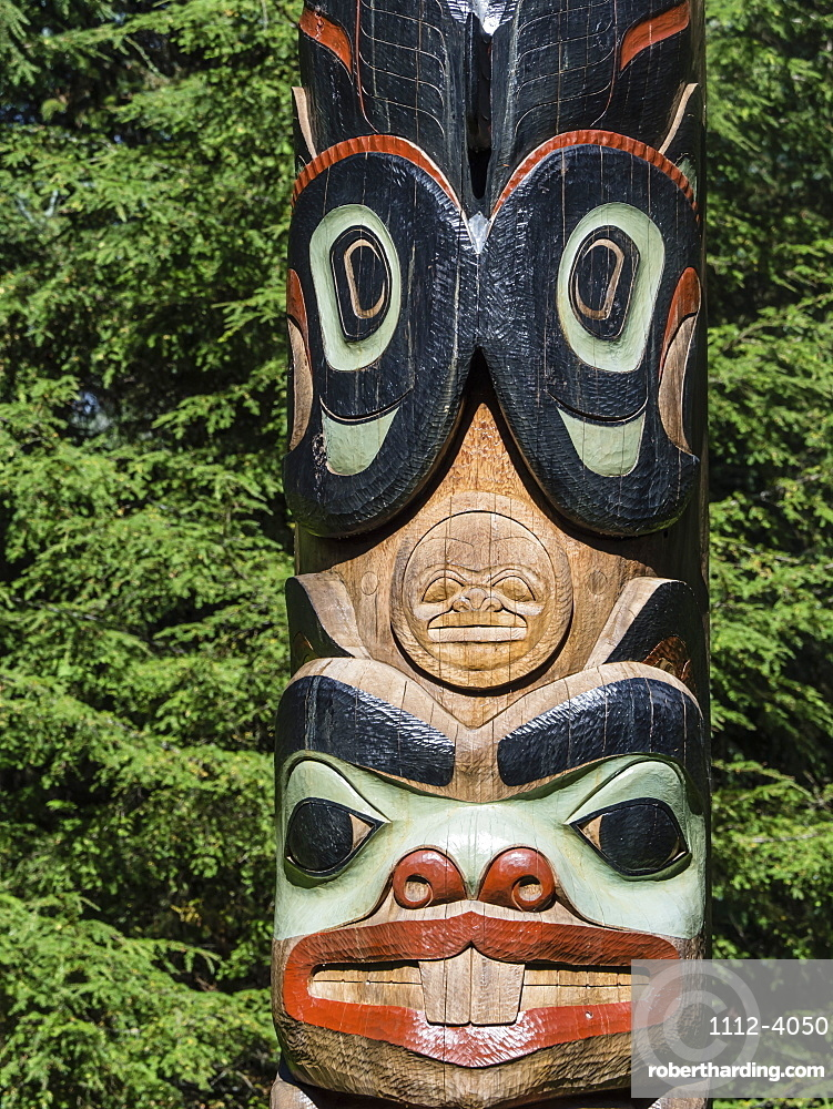 Detail of a totem pole on display at Sitka National Historical Park in Sitka, Baranof Island, Southeast Alaska, USA.
