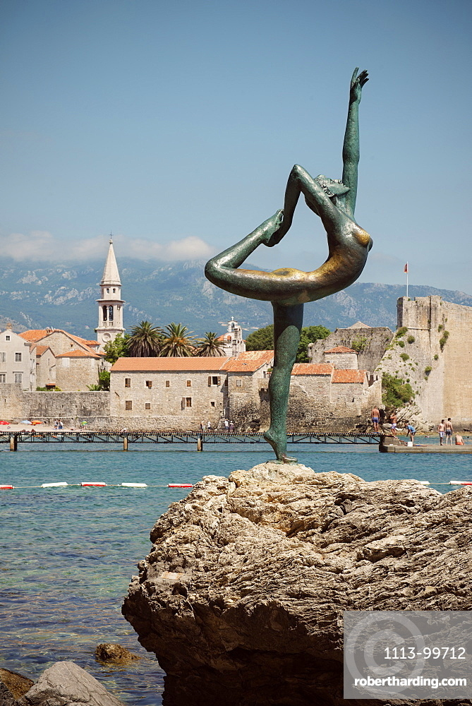 Sculpture of a nude female acrobat in front of old town of Budva, Stari Grad, Adriatic coastline, Montenegro, Western Balkan, Europe