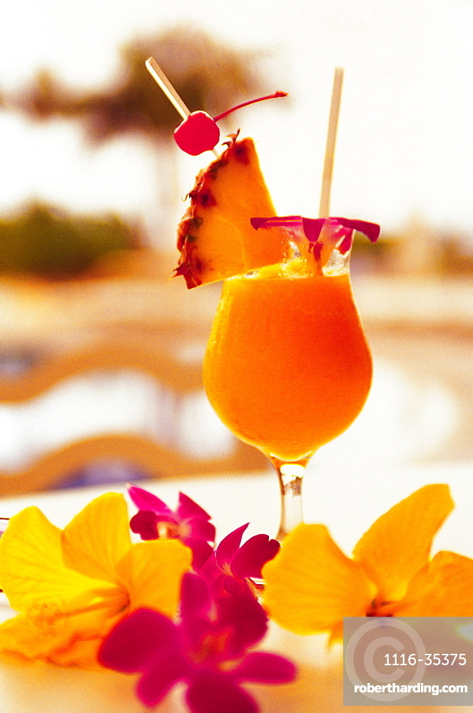 Tropical drink with tropical flowers