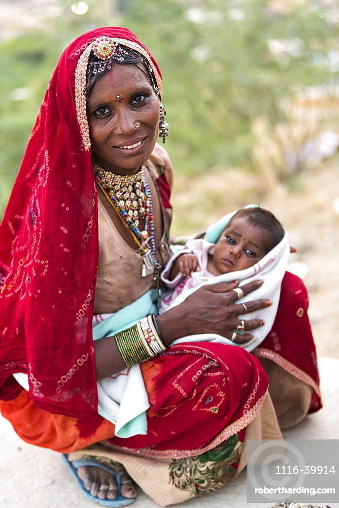 A mother holding her baby girl, Jaisalmer, Rajasthan, India