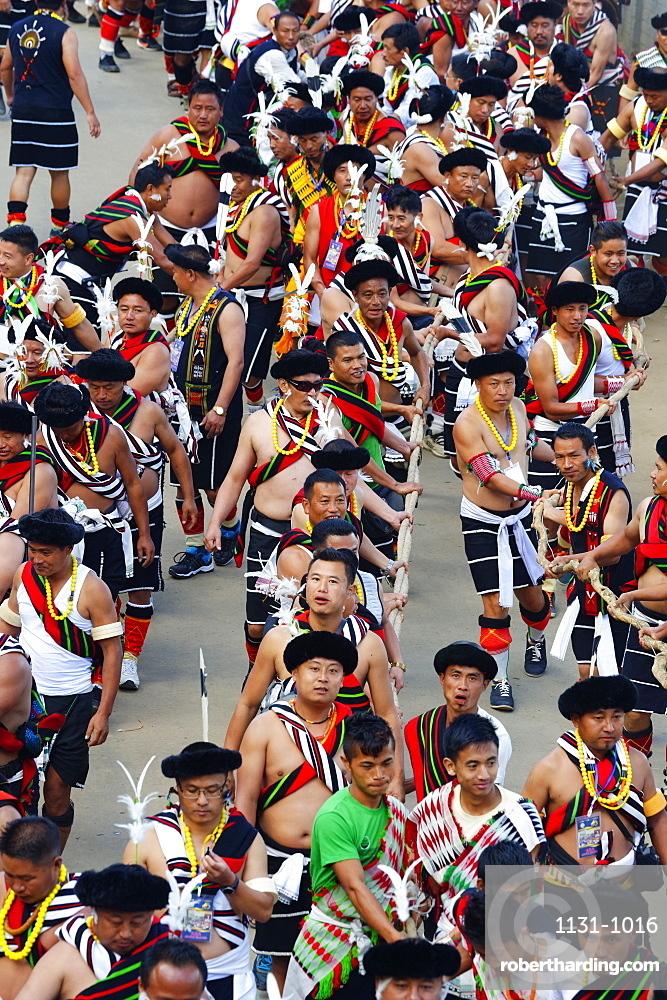 Naga tribesmen participating at the Stone pulling ceremony during Kisima Nagaland Hornbill festival, Kohima, Nagaland, India, Asia