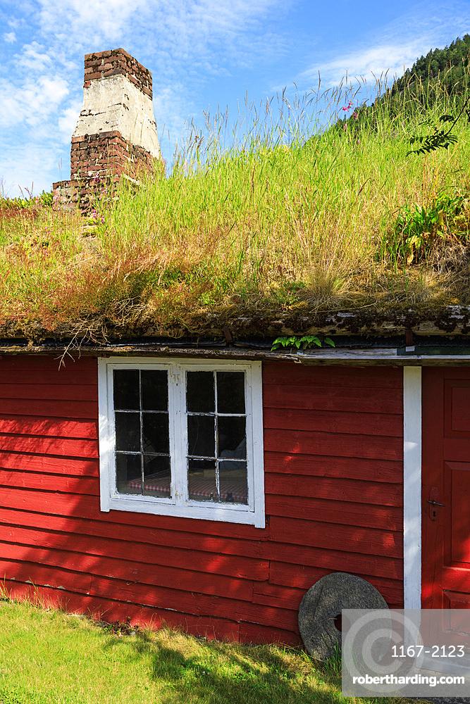 Turf roof, wooden red cottage, Haereid mountain plateau, sunny day, beautiful Eidfjord, Norwegian Western Fjords, Norway, Europe