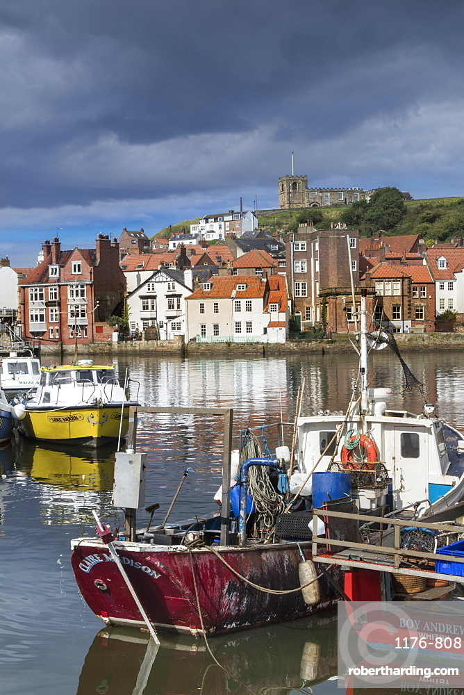View of fishing boats in the harbour and the town centre, Whitby, Yorkshire, England, United Kingdom, Europe