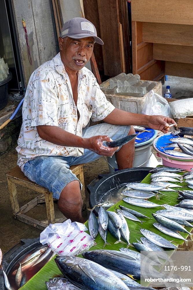 Indonesia, Seram, Masohi, a man selling fish in the local city market