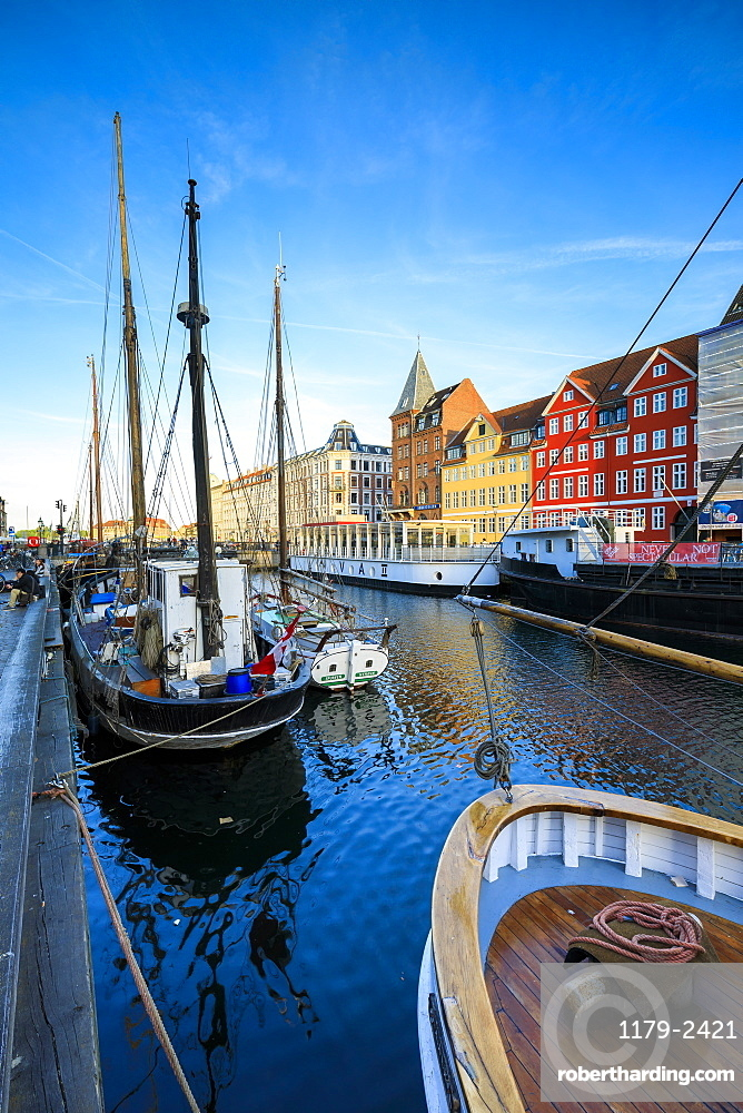 Boats in Christianshavn Canal with typical colorful houses in the background, Copenhagen, Denmark, Europe