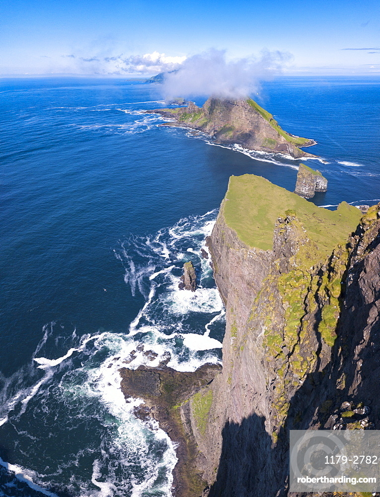 Panoramic of the sea stacks of Drangarnir and Tindholmur islet, Vagar Island, Faroe Islands, Denmark, Europe (Drone)