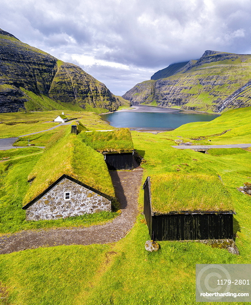 Elevated view of typical grass roof (turf roof) houses, Saksun, Streymoy Island, Faroe Islands, Denmark, Europe (Drone)