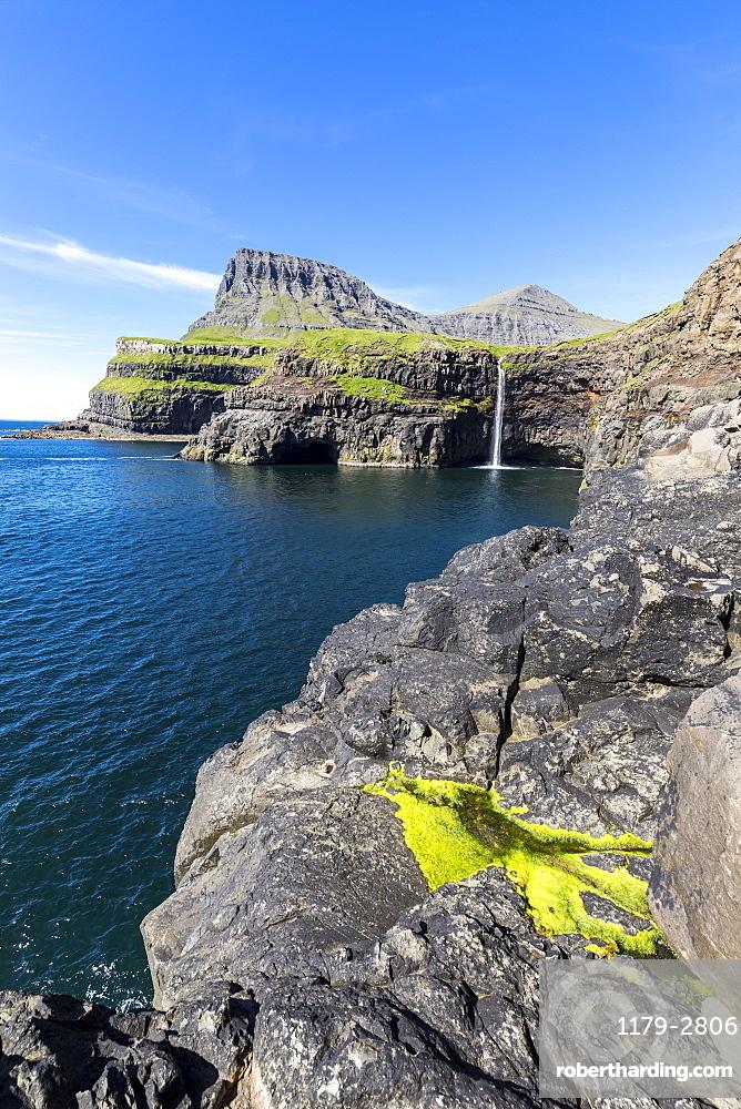 Cliffs around Mulafossur Waterfall in summer, Gasadalur, Vagar Island, Faroe Islands, Denmark, Europe