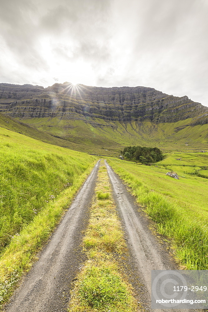 Path through green meadows, Kunoy Island, Nordoyar, Faroe Islands, Denmark, Europe