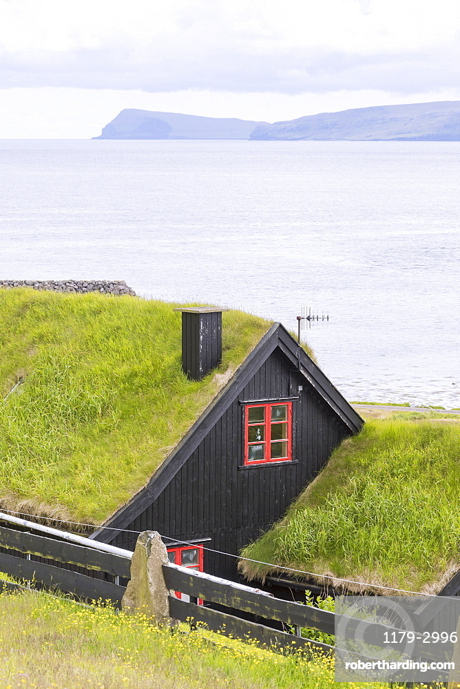 Traditional houses with grass (turf) roof, Kirkjubour, Streymoy island, Faroe Islands, Denmark, Europe