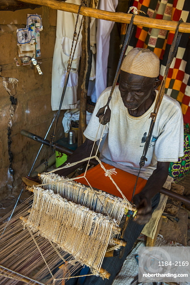 Man weaving on a traditional loom in the National Museum, Niamey, Niger, Africa