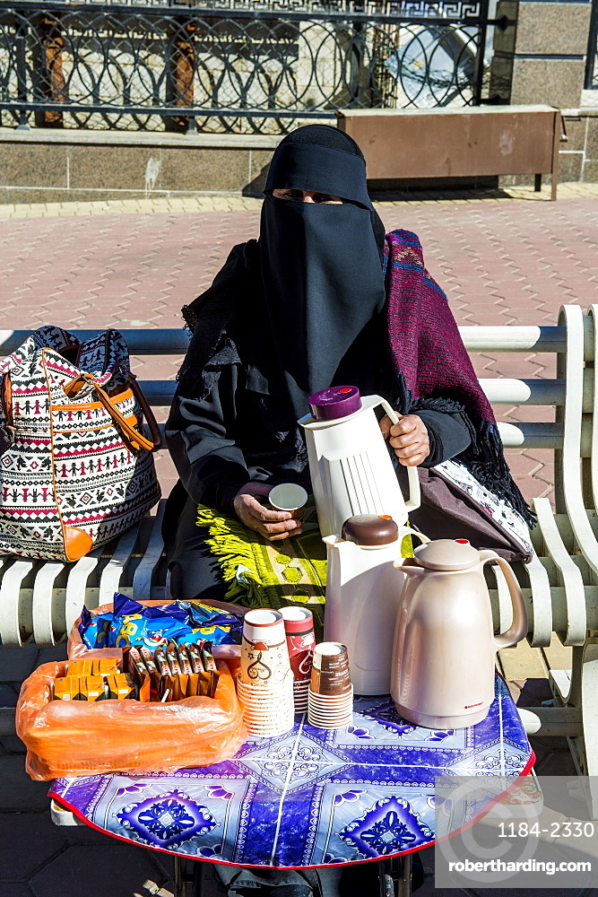 Woman selling arabian coffee, Abha, Saudi Arabia, Middle East