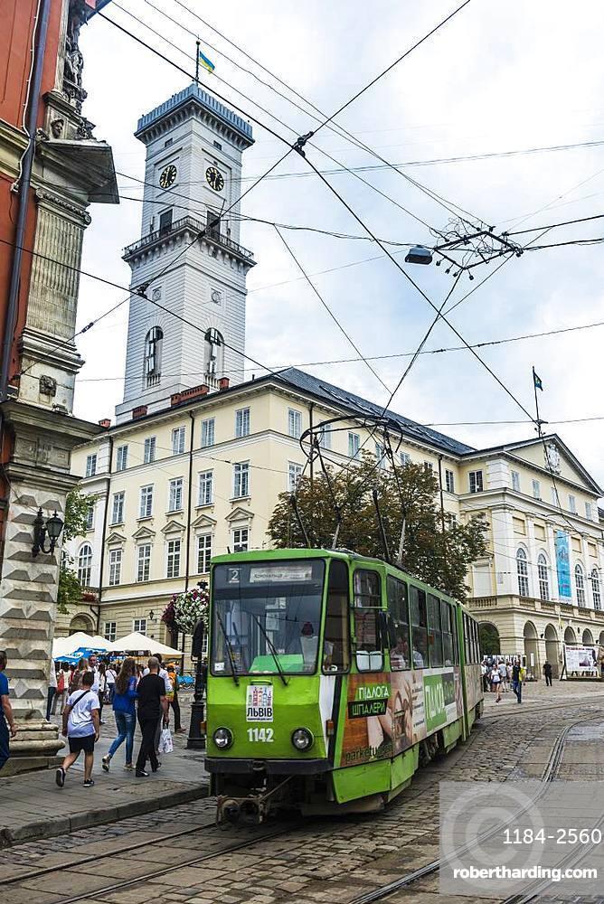 Tram in front of the Lviv City Council building, Lviv, UNESCO World Heritage Site, Ukraine, Europe