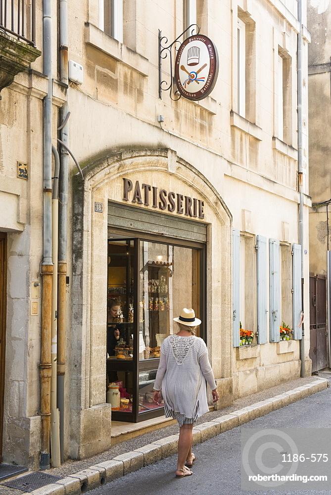 Woman walking through Martigues, Bouches-du-Rhône, France,