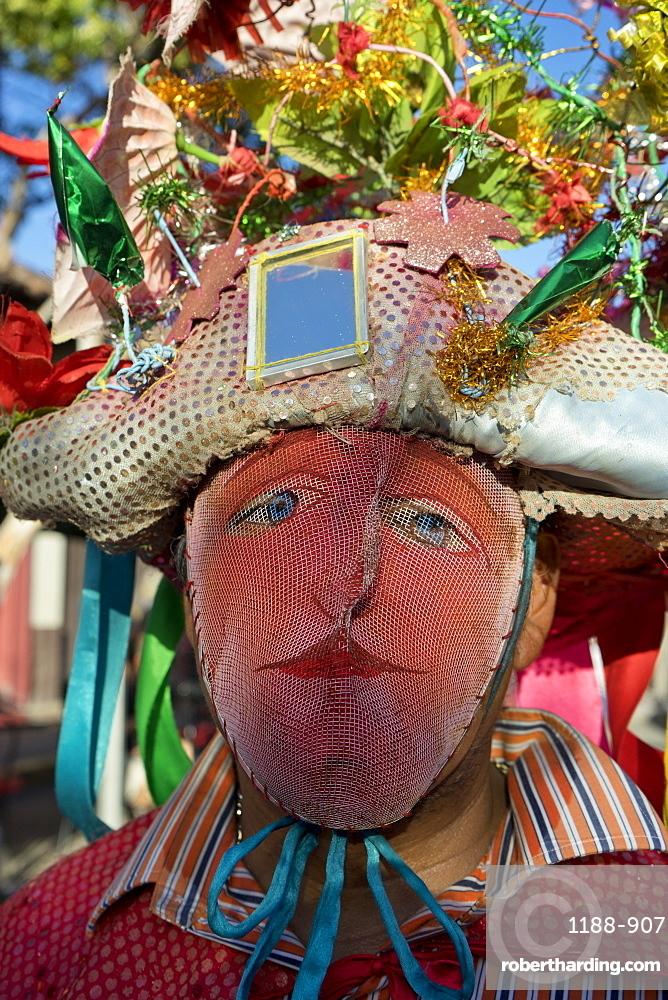 Masked reveller at carnival parade in Granada, Nicaragua, Central America