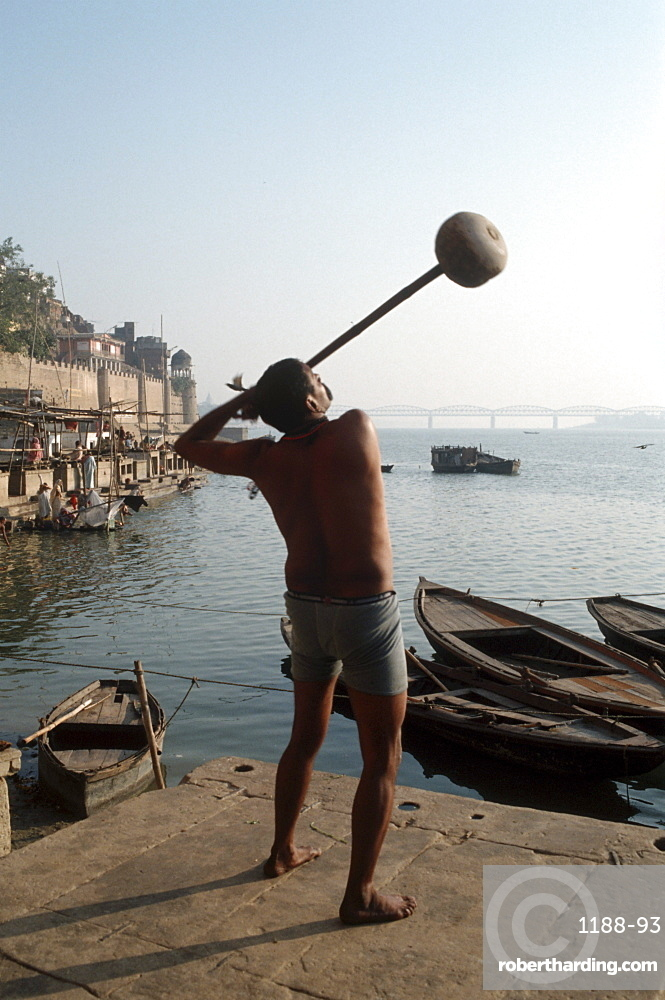 India, varanasi, wrestlers on the banks of the holy ganges river.