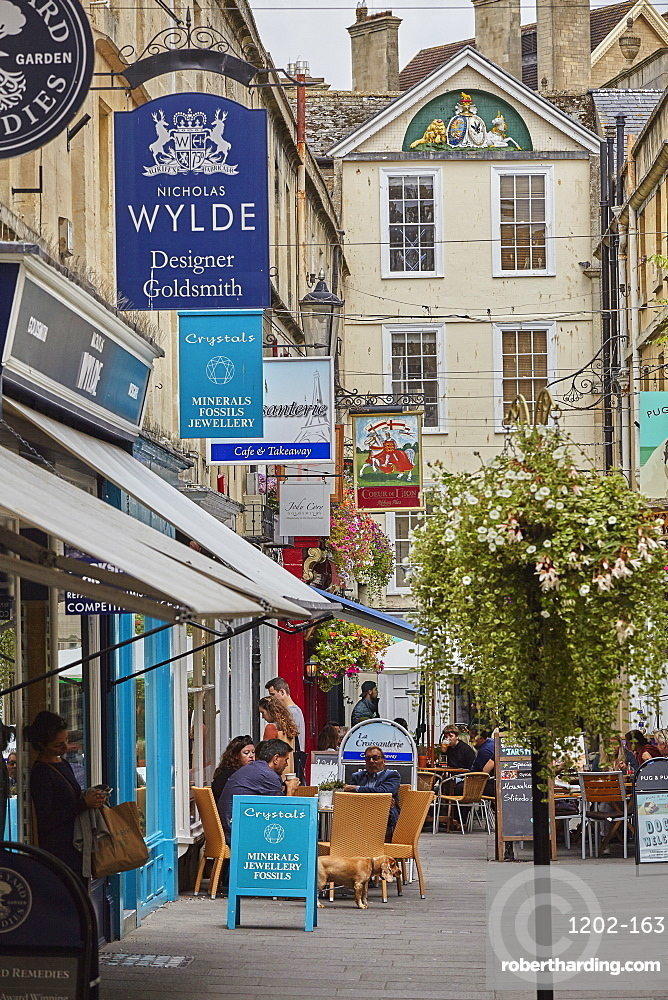 Historic architecture and a street scene in the historic heart of Bath, Somerset, Great Britain.
