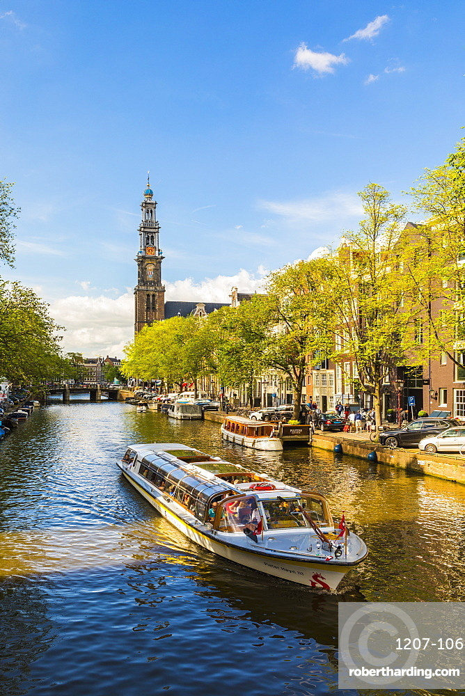 Boat on Prinsengracht Canal, with Westerkerk in the background, Amsterdam, Netherlands, Europe