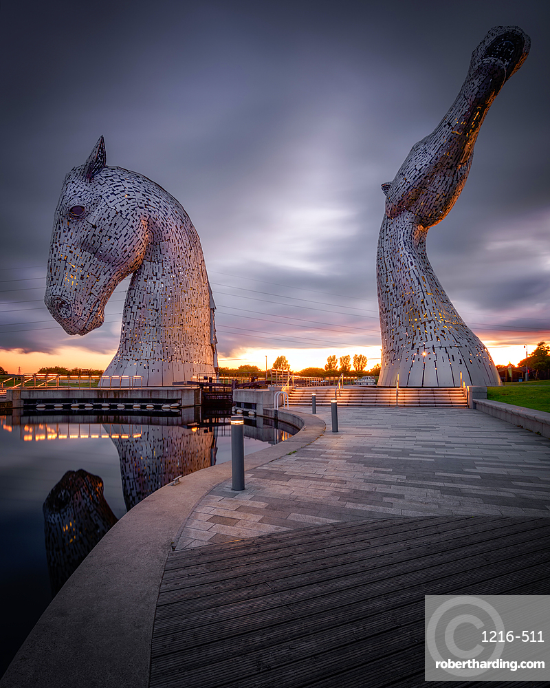 The Kelpies at sunset, Forth and Clyde Canal at Helix Park, Falkirk, Stirlingshire, Scotland, United Kingdom