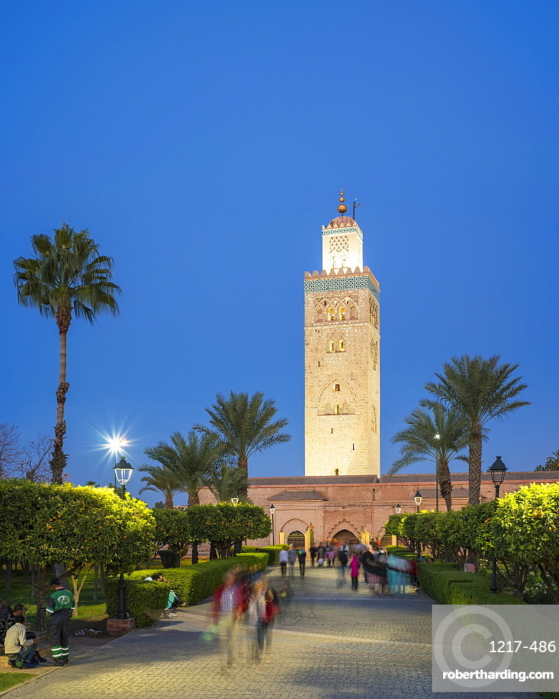 Minaret of the 12th century Koutoubia Mosque, UNESCO World Heritage Site, and Parc Lalla Hasna at dusk, Marrakesh, Morocco, North Africa, Africa