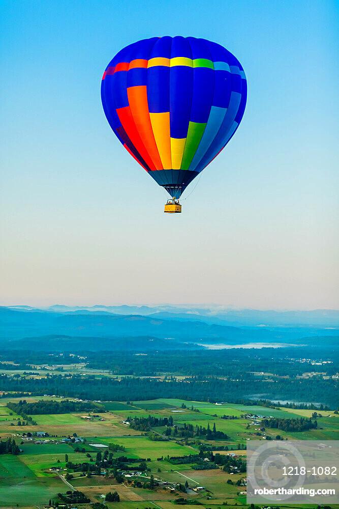 Hot air balloon over Auburns farmland, Washington State, United States of America, North America