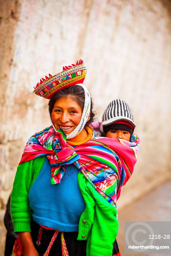 Traditional Peruvian Incan woman and her child, Ollantaytambo, Peru, South America