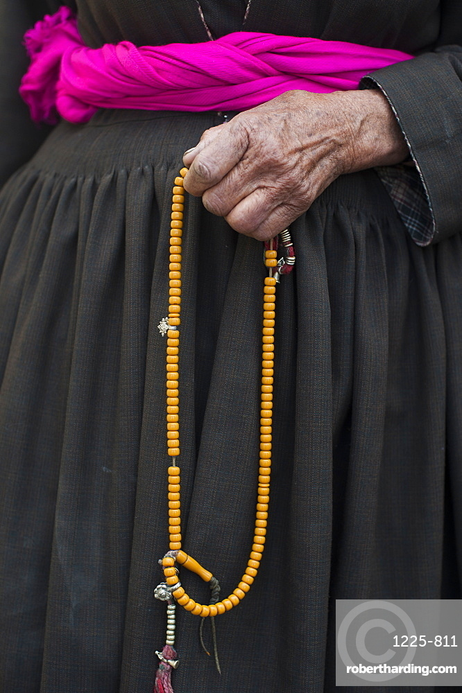 108 beads are strung on a garland of Buddhist prayer beads, with the beads typically made of fragrant wood like sandalwood, Ladakh, India, Asia