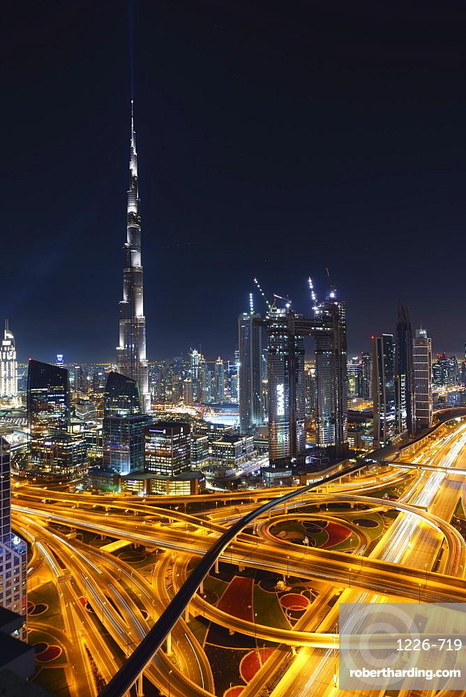 Dubai skyline and Sheikh Zayed Road Interchange by night, Dubai, United Arab Emirates, Middle East