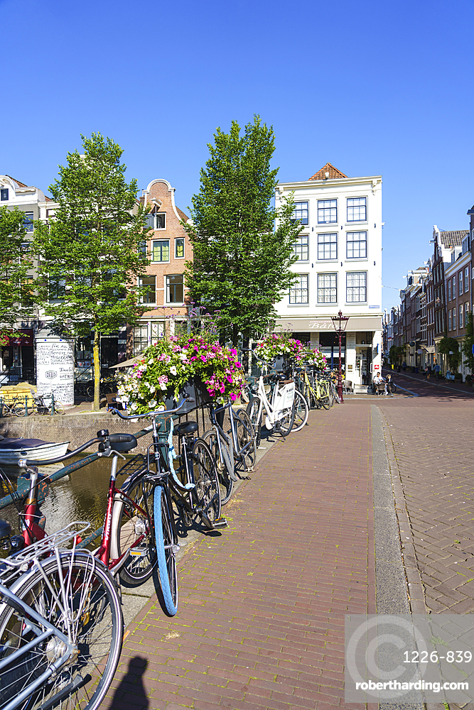 Bicycles on a bridge over the Herengracht canal, Amsterdam, Netherlands