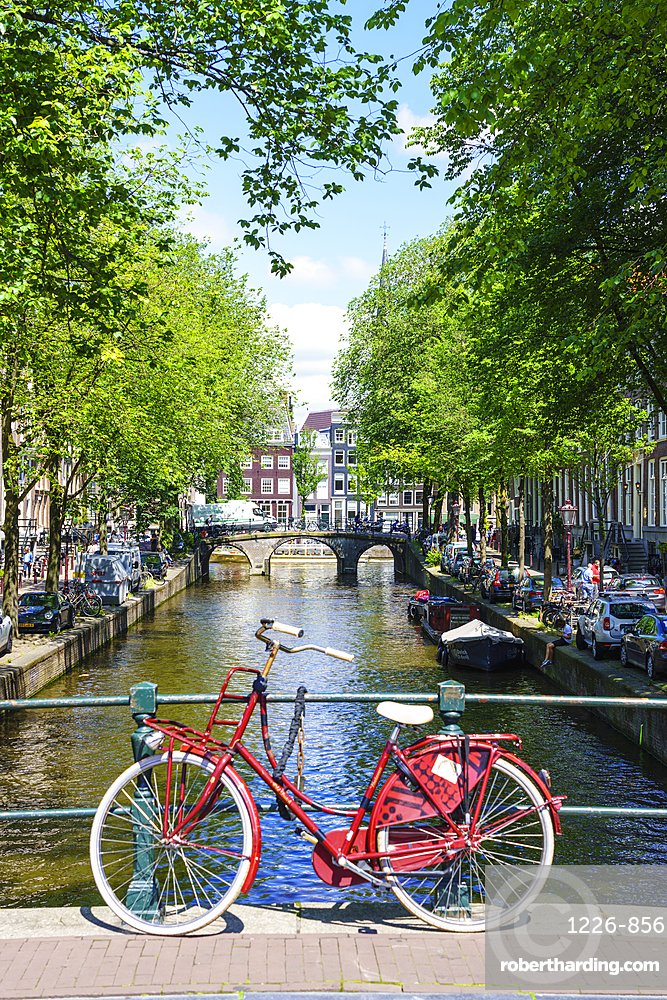 Bicycle on a bridge, Leidsegracht canal, Amsterdam, Netherlands