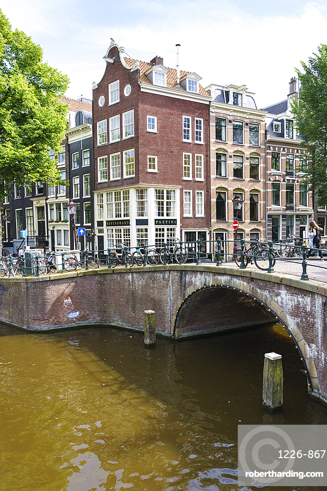 Old gabled buildings by a bridge on Keizersgracht, Amsterdam, Netherlands