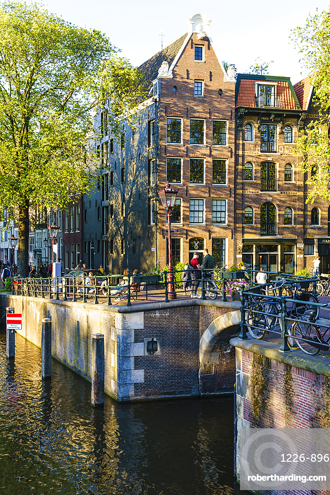 Golden hour light on old gabled buildings, Brouwersgracht, canal, Amsterdam, Netherlands