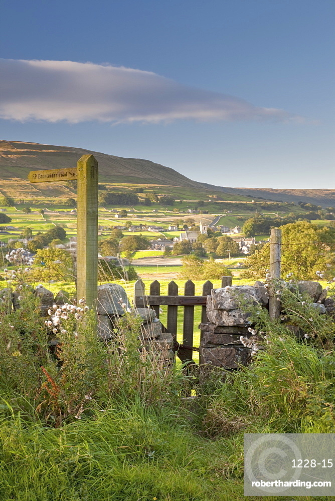 A footpath signpost and gate leading to Hawes village in Wensleydale, The Yorkshire Dales, Yorkshire, England, United Kingdom, Europe