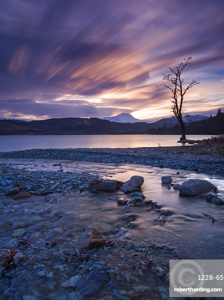 Sun setting over Ben Lomond and Loch Ard near Aberfoyle in the Lomond Trossachs National Park, Stirling, Scotland, United Kingdom, Europe