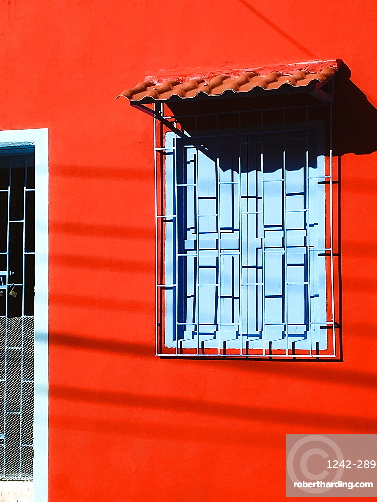Red house with blue window, Cartagena, Colombia, South America