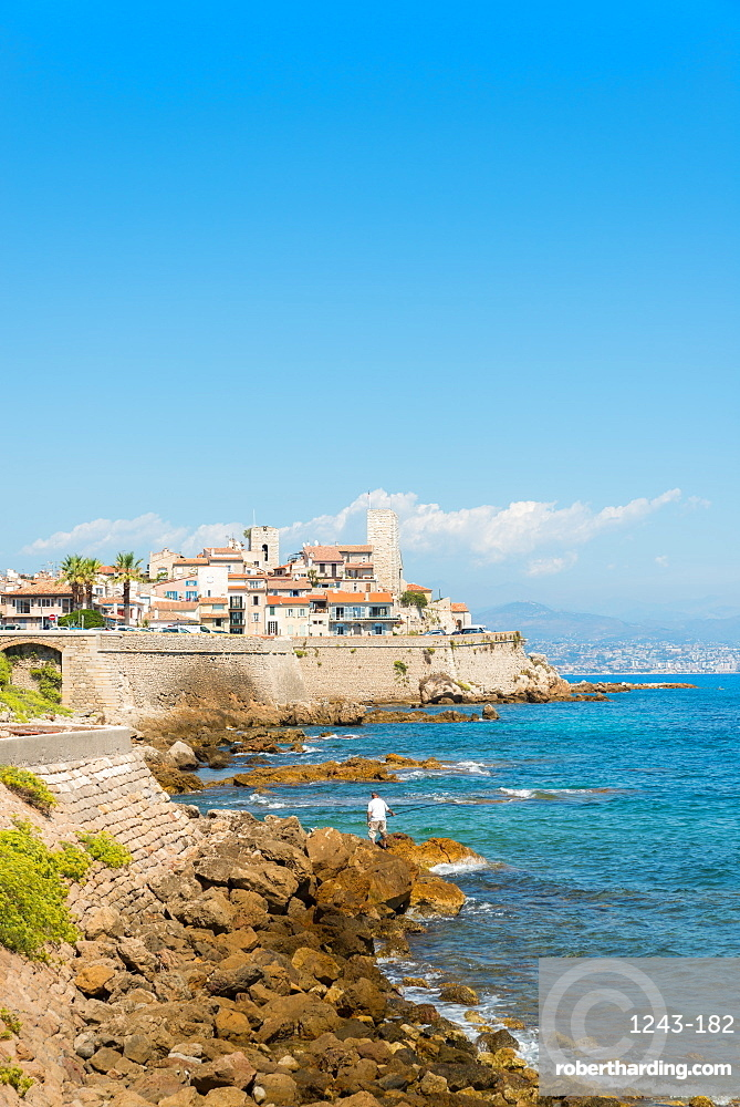 Fisherman overlooking the Old Town of Antibes, Provence, France, Mediterranean, Europe
