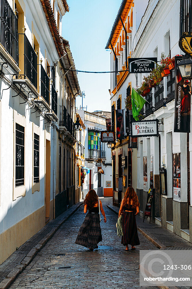 Tourists in narrow pedestrian streets of Cordoba, Andalucia, Spain