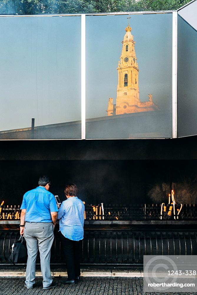 Religious pilgrims light candles at Sanctuary of Fatima (Basilica of Our Lady of Fatima), Portugal, Europe