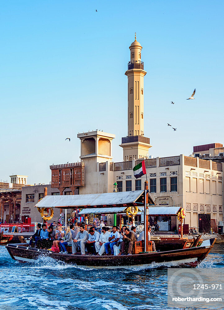 Abra Boat on Dubai Creek, Bur Dubai Grand Mosque in the background, Dubai, United Arab Emirates, Middle East