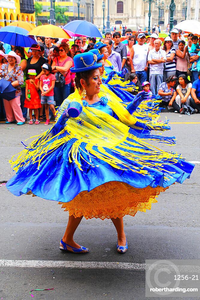 Local women dancing during Festival of the Virgin de la Candelaria in Lima, Peru.
