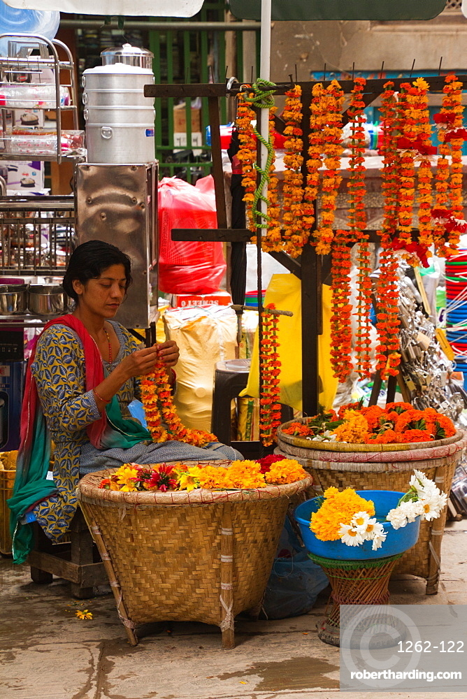 Flower garland seller on the streets of Kathmandu, Nepal, Asia