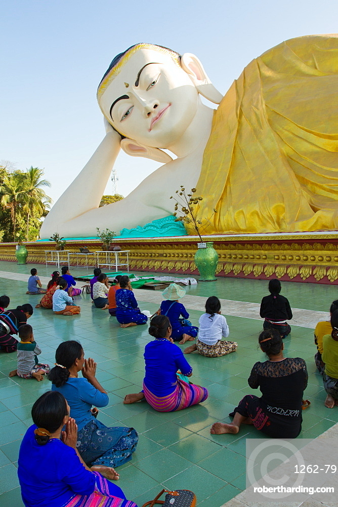 Reclining Buddha and Buddhist devotees of Bagan, Myanmar