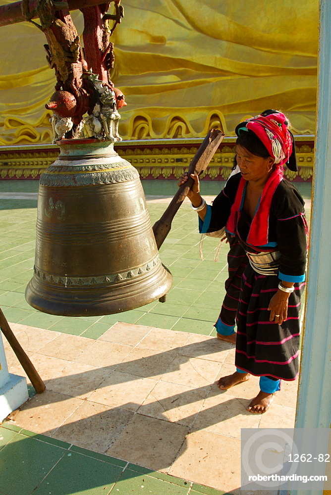 Buddhist bell and devotee, Bagan (Pagan), Myanmar (Burma), Asia