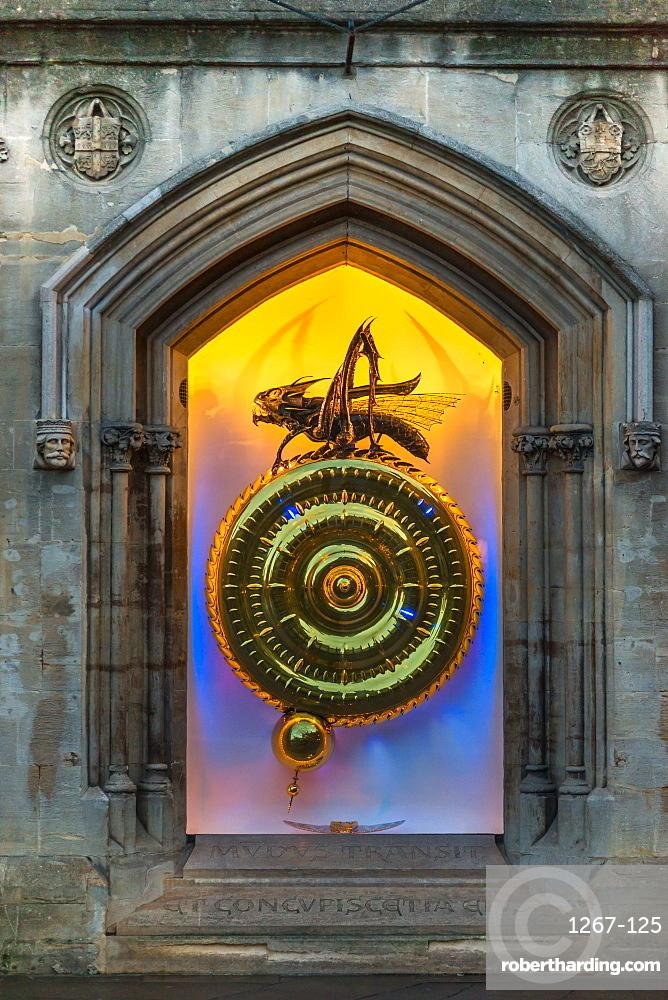 Night time view of the illuminated Corpus Christi Clock with Chronophage (Time Eater), Cambridge, Cambridgeshire, England, UK