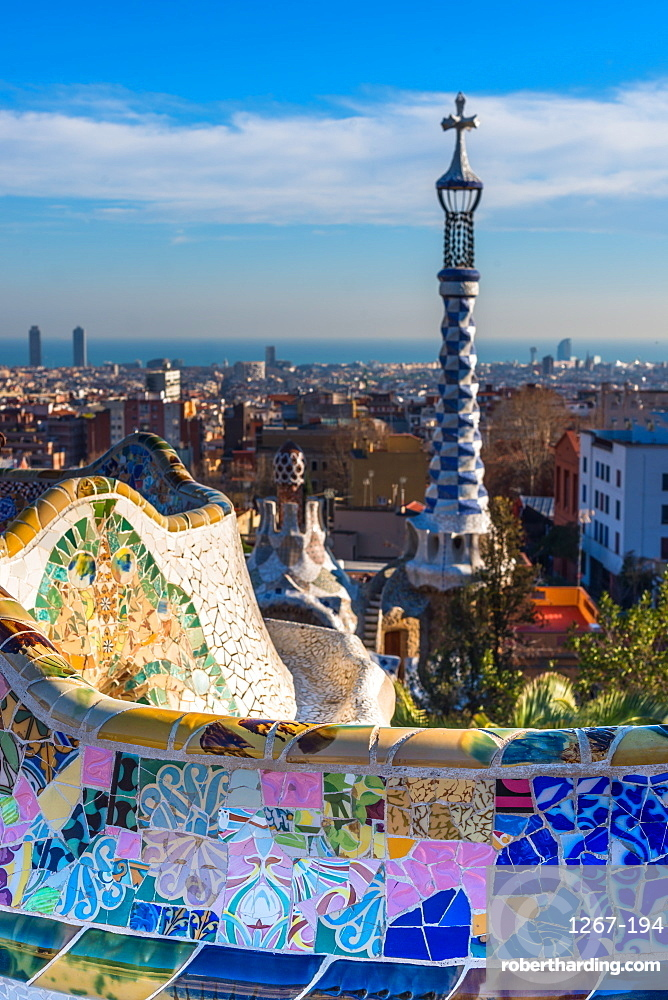 Park Guell houses and mosaic tiles at Parc Guell by Antoni Gaudi, UNESCO World Heritage Site, with views over the city to the sea, Barcelona, Catalonia, Spain, Europe